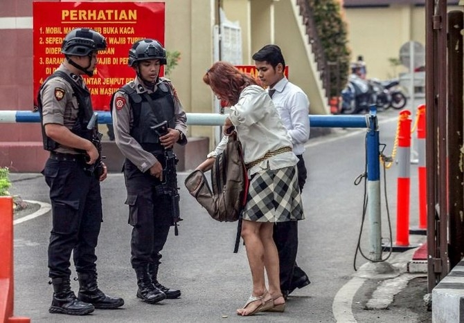 Officer, 4 attackers dead in Indonesia police station assault