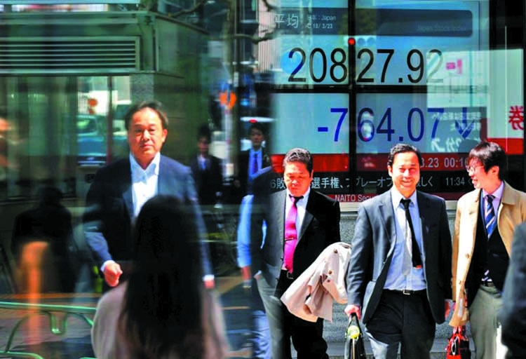 Strong dollar hits Asian share markets