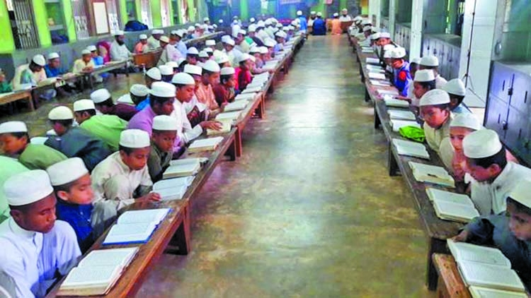 Who are qawmi madrassa pupils?