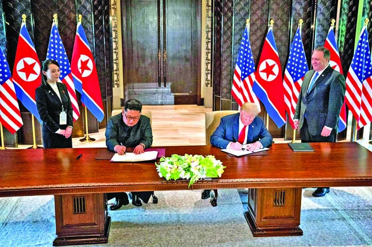 Trump and Kim finally sign  'comprehensive' document