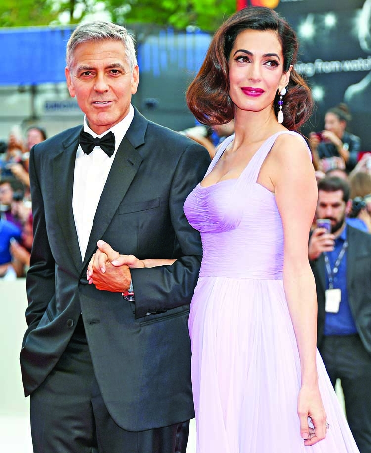 George, Amal Clooney donate $100K to aid migrant children
