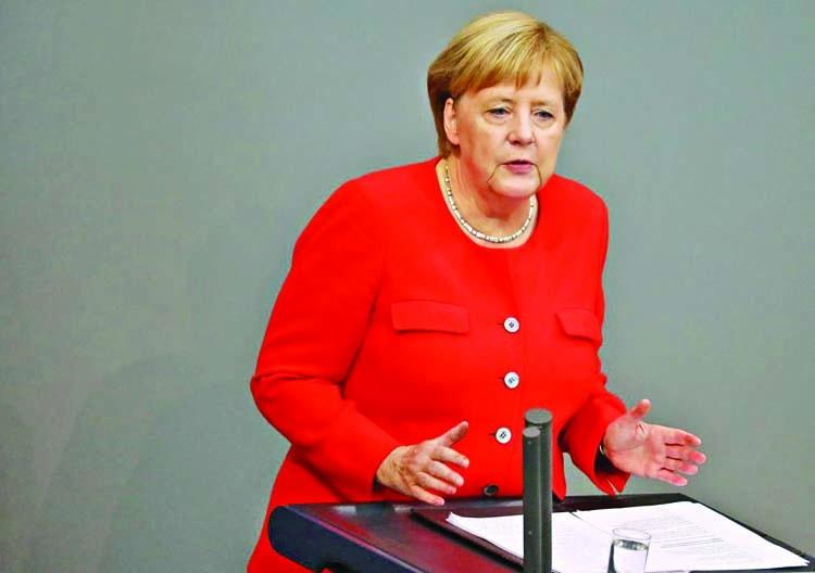 Merkel condemns far-right xenophobia, Nazi slogans