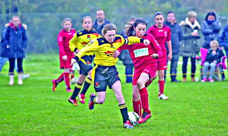 Why do some schools still ban  girls from playing football?