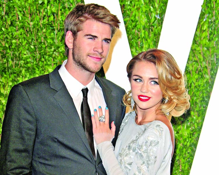 Liam opens up about his wife Miley taking his surname