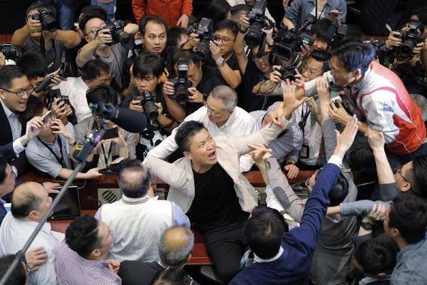 Pandemonium as Hong Kong lawmakers come to blows; several hurt