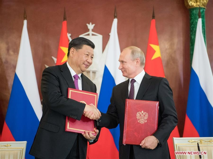 Xi, Putin lead bilateral ties into new era, embark on fresh journey of int'l cooperation