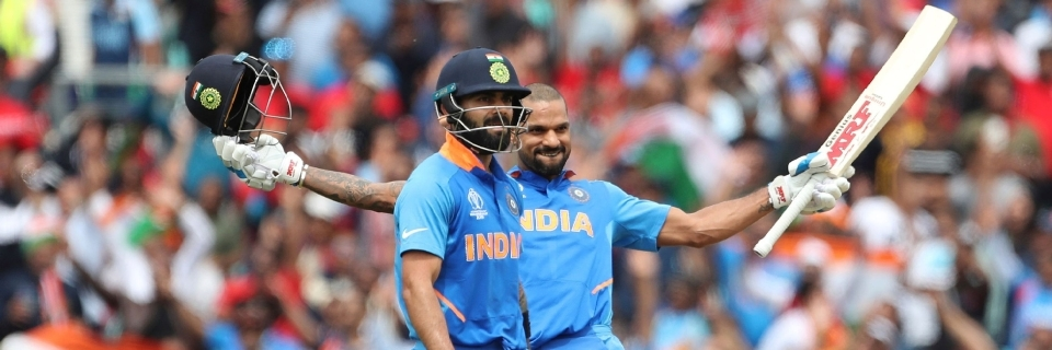 Dhawan's ton powers India to 352