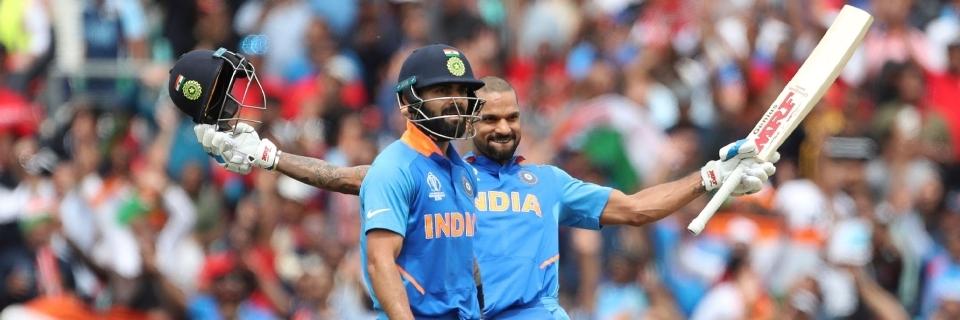 Dhawan's ton powers India to 352