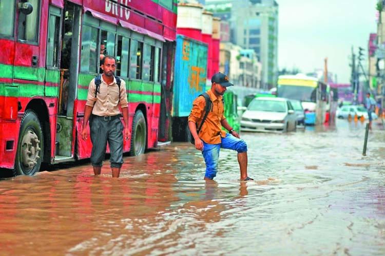 Rain inundates Dhaka