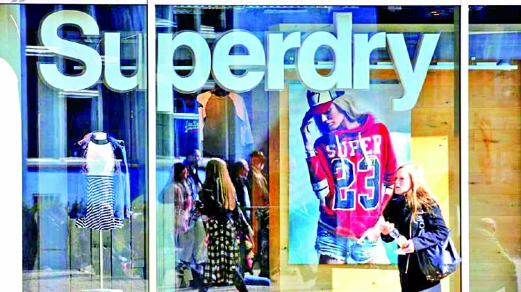 Superdry warns of long road to recovery as slashes store value