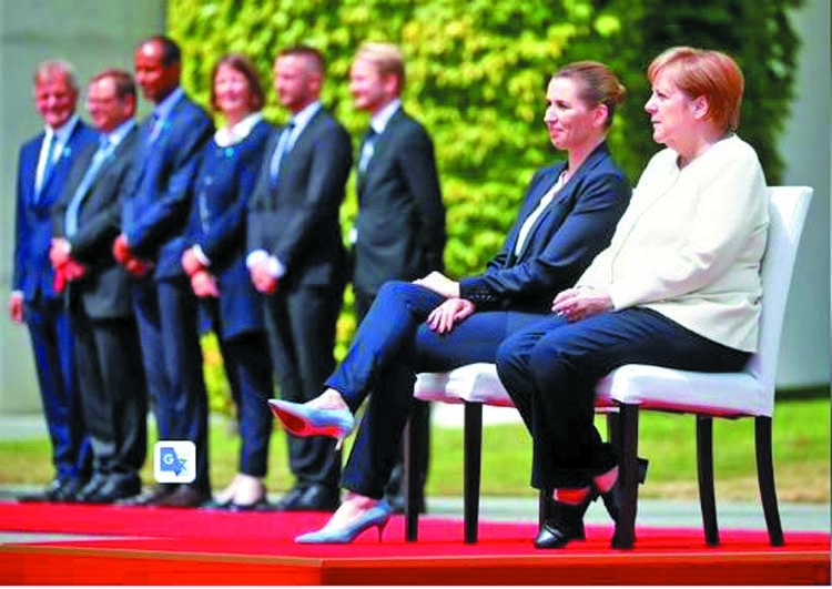 Merkel sits down to welcome Danish PM