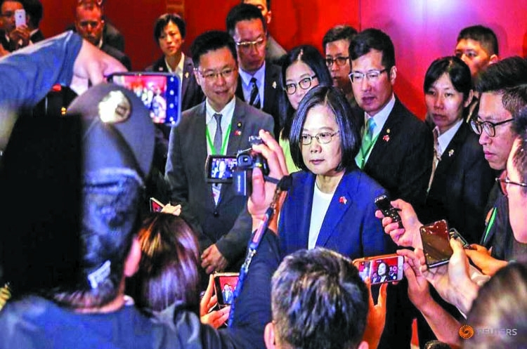 Taiwan president in US after warning