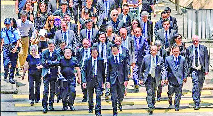 HK lawyers march in silence to support anti-govt protesters