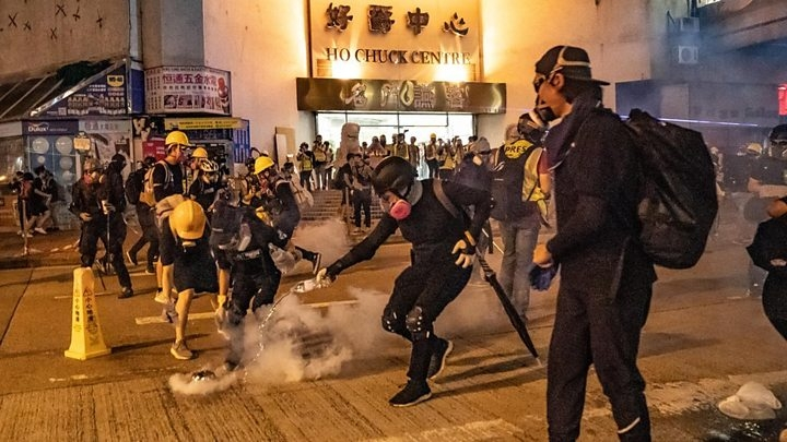 HK clashes as tear gas fired into rail station