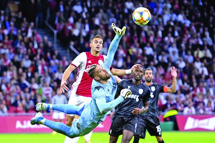Ajax see off PAOK to make Champions League playoffs