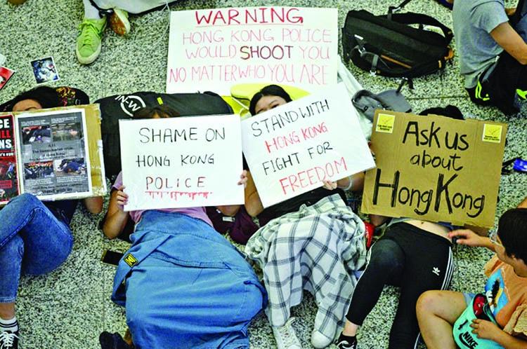 China slams HK airport protesters as 'terrorist-like'
