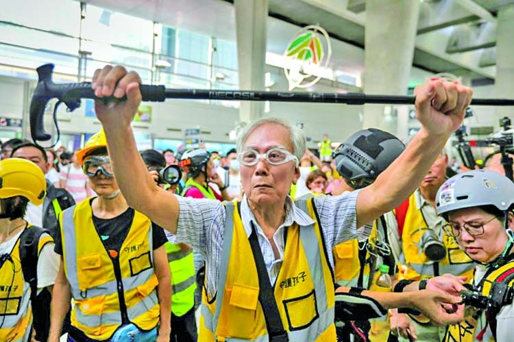 Hong Kong's grandpa protesters speak softly but carry a stick
