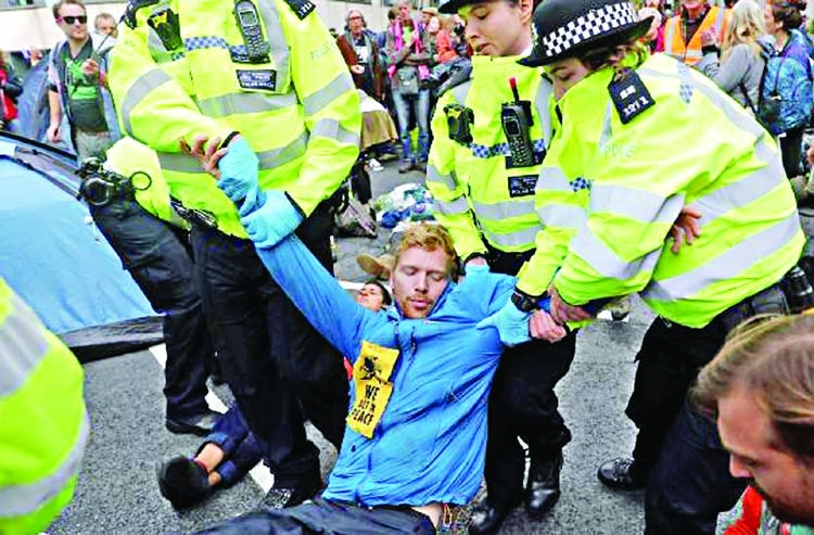 300 held as UK activists vow more protests