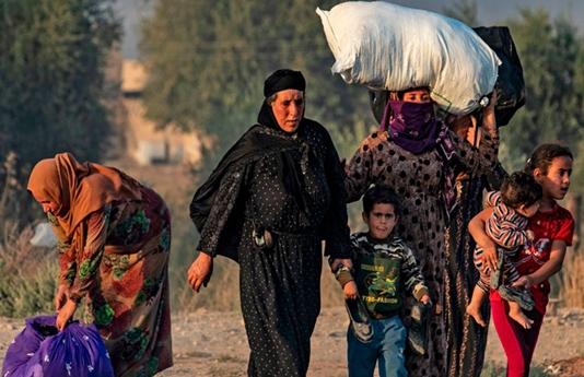 Civilians flee as Syria Kurds battle Turkish invasion