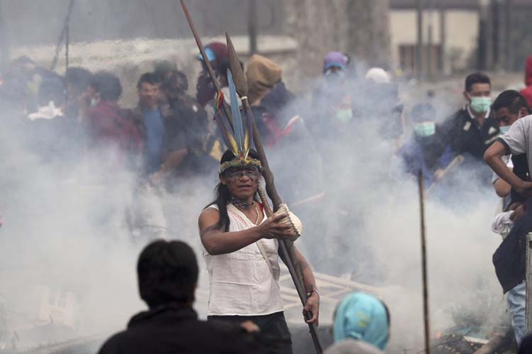 Ecuador clash site has party clowns, recycling, tear gas