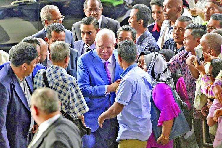 Najib seeks to show he's victim of fugitive
