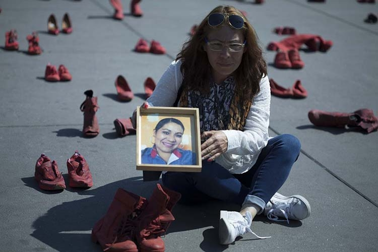 In Mexico City, red shoes to protest killings of women