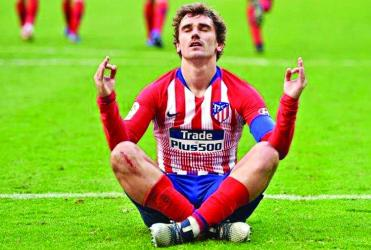 Griezmann double leads Atletico, Real win over Vallecano