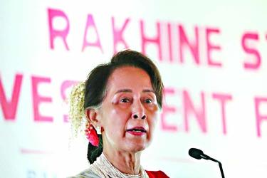 Suu Kyi woos investors to crisis-hit Rakhine