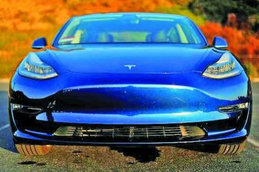 Tesla cuts prices to simplify lineup