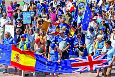 Dozens of Britons march in Spain ahead of Brexit