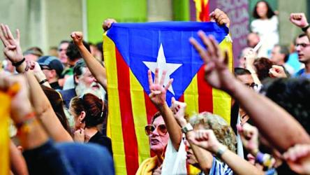 Spain court gives Catalan leaders long jail terms