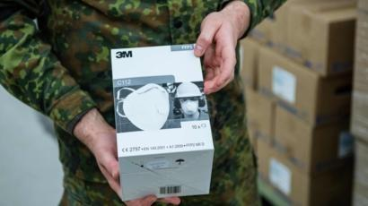 US accused of 'piracy' over mask 'confiscation'