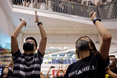 Hong Kong police charge four former Apple Daily staff under security law